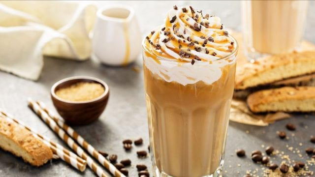 Blended coffee drink with whipped cream and syrup on top