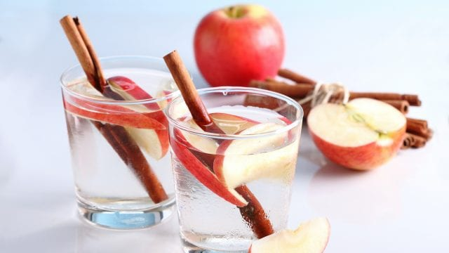 Apples and cinnamon in water